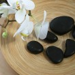 Spa massage stones and orchids — Stock Photo