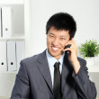Asian Businessman Talking on Cellphone — Stock Photo