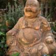 Smiling Buddha statue — Stock Photo #24647617
