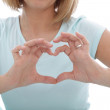 Woman making a heart gesture with her fingers — Stock Photo