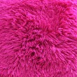 Vivid pink shaggy carpet pile — Stock Photo