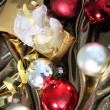 Christmas baubles on gold fabric — Stock Photo #26056109