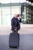 Elderly man waving goodbye — Stock Photo