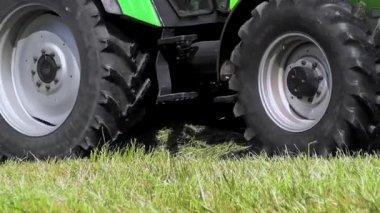 Farmer harvesting grass silage — Stock Video