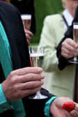 Celebrating with a glass of champagne — Stok fotoğraf