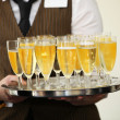 Waiter carrying a tray of champagne — Stock Photo