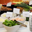 Salads in dishes on a buffet table — Stock Photo