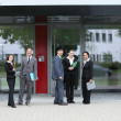 Group of business colleagues outside the office — Stock Photo #27787057