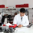 Stock Photo: Young Asian laboratory technician