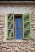 Window with green wooden shutters — Foto de Stock