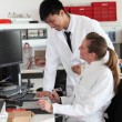 Two lab technicians discussing their work — Stock Photo