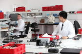 Technicians working in a modern laboratory — Stock Photo