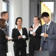 Stock Photo: Group of diverse businesspeople on coffee break