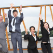 Stock Photo: Successful business team cheering and rejoicing