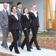 Stylish young business team walking together — Stock Photo