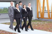 Stylish young business team walking together — Foto de Stock
