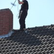 Chimney sweep at work on the roof — Foto de Stock