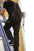 Chimney sweep climbing a stepladder — Stock Photo