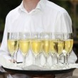 Waiter with a tray of champagne flutes — Stock Photo