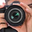 Man focusing his camera — Stock Photo
