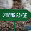 Green left arrow towards the driving range — Stock Photo
