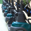 High quality modern golf carts aligned — Stock Photo