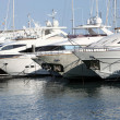 Foto Stock: Row of luxury motorised yachts