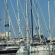 Foto Stock: Masts and rigging of yachts moored in harbour