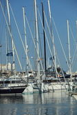 Masts and rigging of yachts moored in harbour — Stock Photo