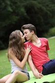Romantic young teenage couple kissing — Stock Photo