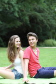Young teenage couple in the park — Stock Photo