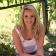 Smiling blond woman relaxing in the shade — Foto de Stock