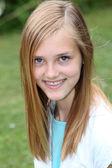 Smiling teenage girl with braces on her teeth — Stock Photo