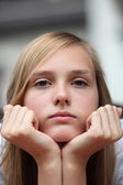 Bored young girl staring at the camera — Stock Photo