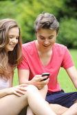 Happy young teenage boy and girl — Stock Photo
