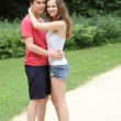 Happy couple of teenagers hugging each other — Foto Stock