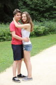 Happy couple of teenagers hugging each other — Stockfoto