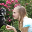 Young girl with her little dog — Stockfoto