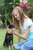 Teenager caressing her miniature pinscher — Fotografia Stock