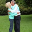 Romantic senior couple kissing — Stock Photo