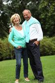 Laughing relaxed elderly couple — Stock Photo