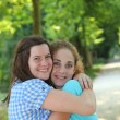 Two young teenage friends hugging — Stock Photo