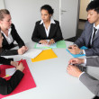 Group of serious business people in a meeting — Stock Photo