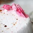 Pink icing roses on a wedding cake — Stock Photo