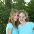 Stock Photo: Pretty young girls in matching blue tops