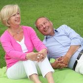 Happy laughing elderly couple — Stock Photo