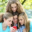 Teenage girls reading an sms message — Stock Photo