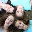 Four smiling attractive teenage girls — Stock Photo