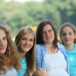 Row of happy teenage girls — Stockfoto