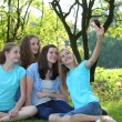 Teenage girls photographing themselves — Stok fotoğraf
